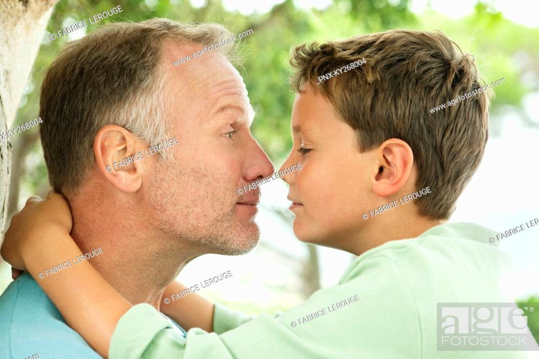 Stock Photo: Man and his son rubbing noses.