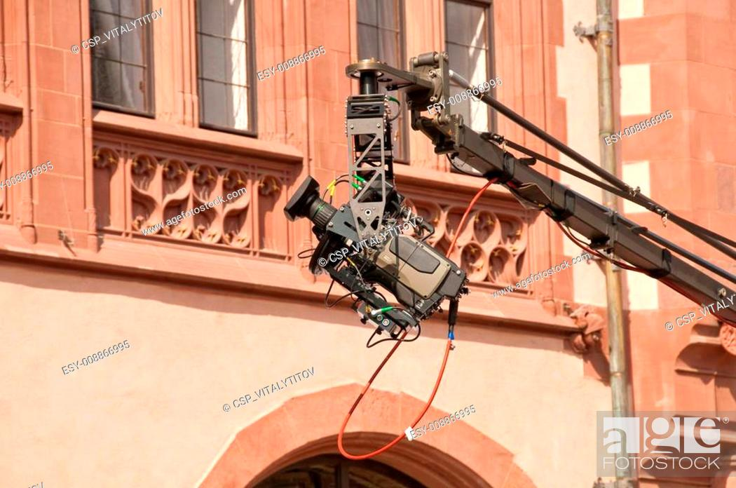 Stock Photo: Professional video filming in city center in European town.