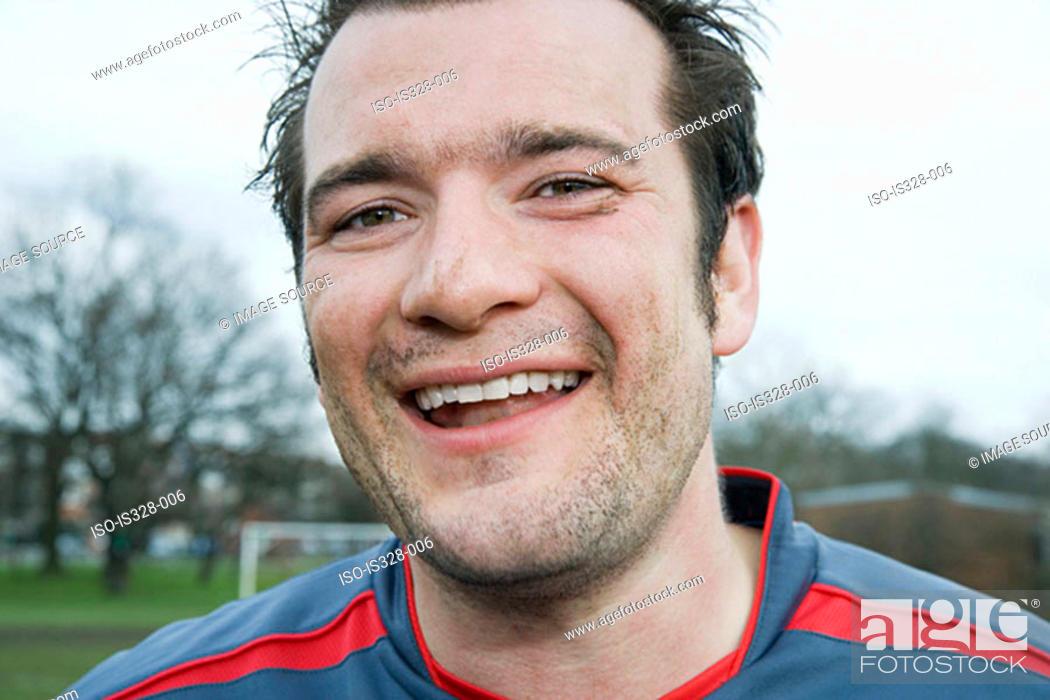 Stock Photo: Smiling footballer.