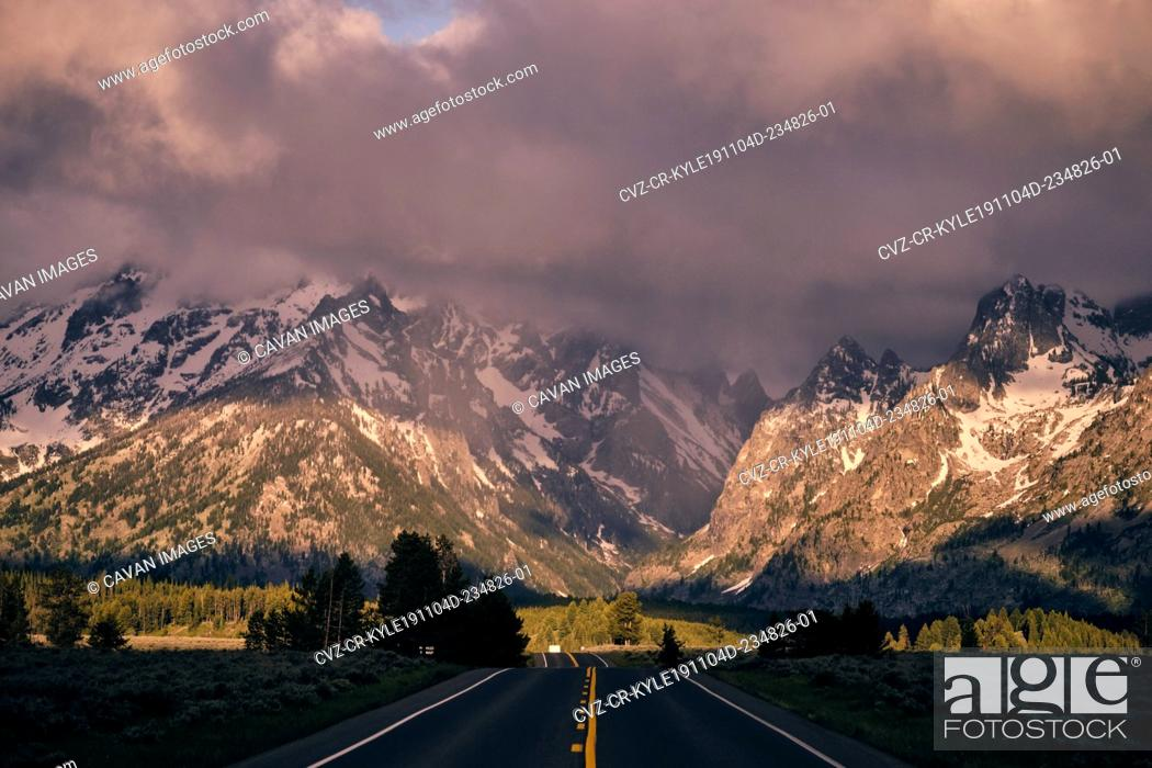 Stock Photo: The road to Grand Teton at first light from the middle of the road.