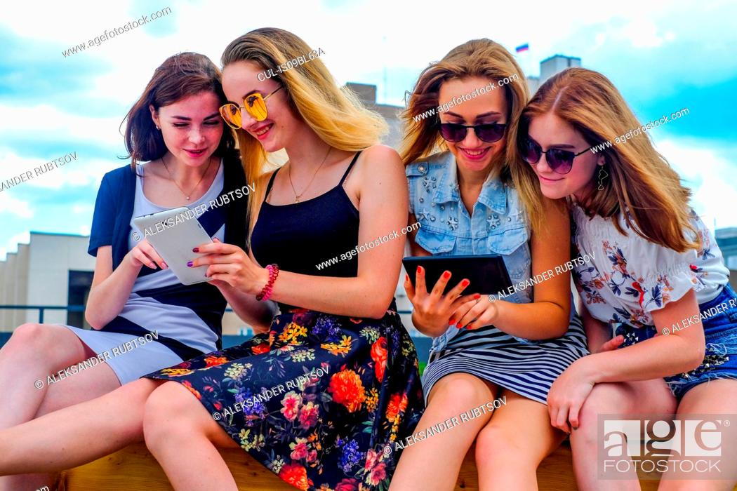 Stock Photo: Friends on vacation using digital tablet.