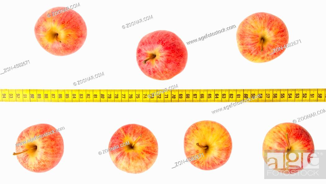 Stock Photo: Apple diet, red apples with a yellow tape-measure.