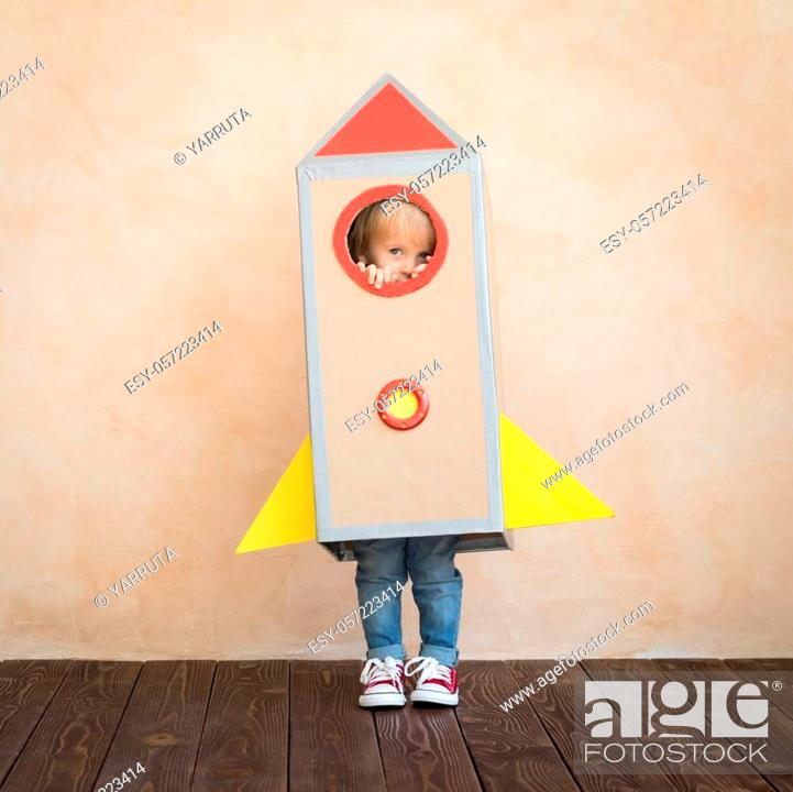 Stock Photo: Happy child pretend to be businessmen. Funny kid playing at home. Education, start up and business idea concept.