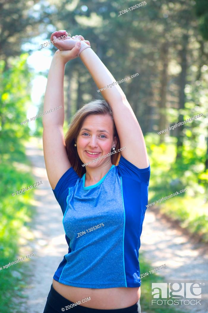 Stock Photo: Running woman. Female Runner Jogging during Outdoor Workout in a Park. Beautiful fit Girl. Fitness model outdoors. Weight Loss. Healthy lifestyle.