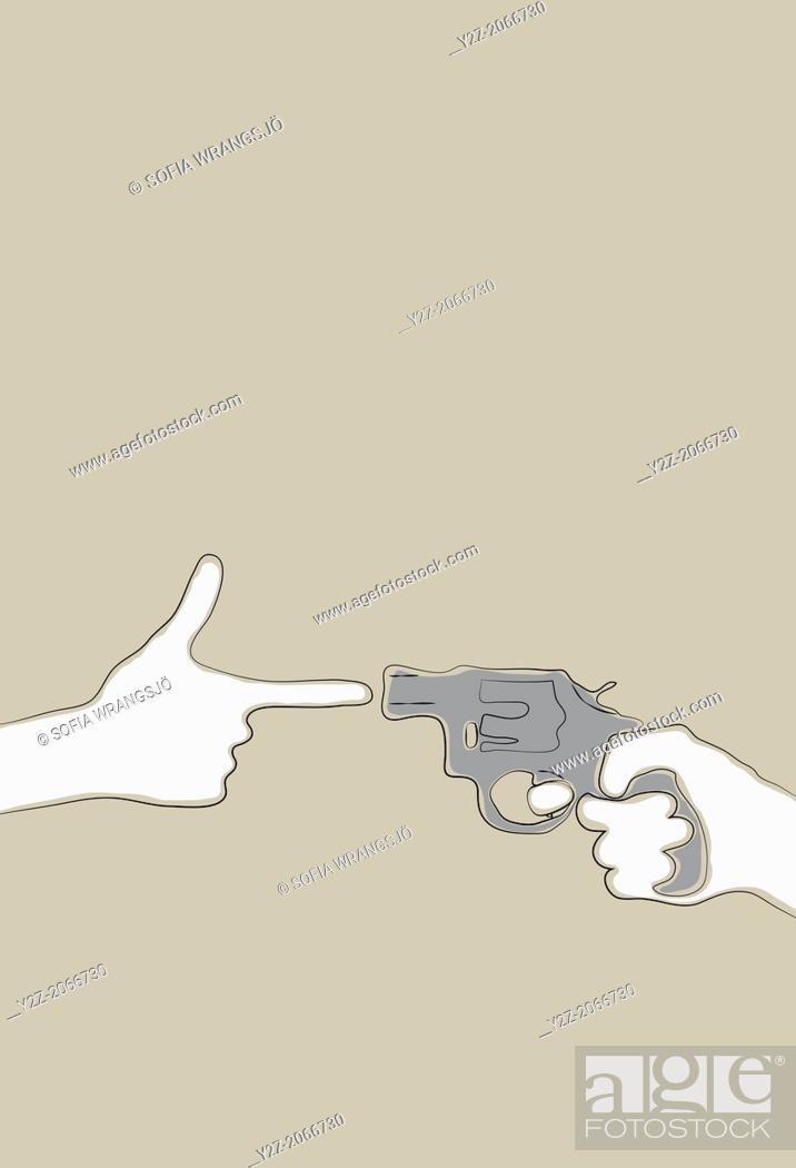Stock Photo: Hand making gun gesture pointing at a revolver.