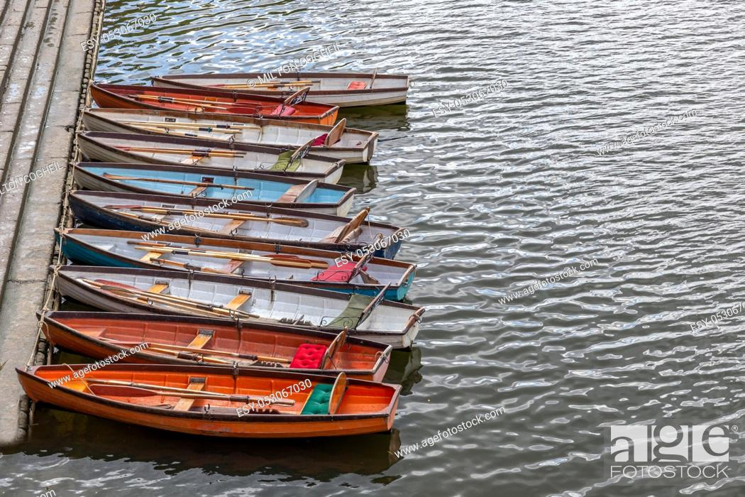 Stock Photo: Wooden boats for hire moored on the River Thames, UK.