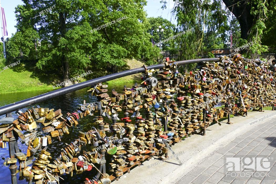 Stock Photo: Lovelocks on a bridge in Riga, Latvia.