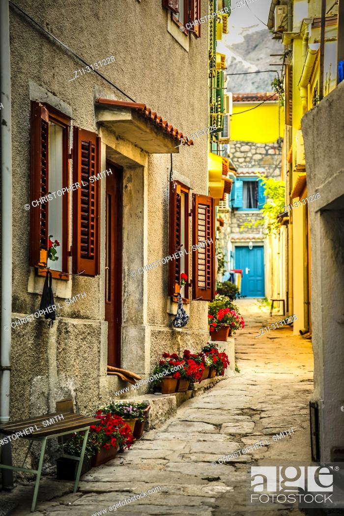Stock Photo: Croatian homes along narrow streets in the small fishing village of Baska on the island of Krk in the Adriatic.
