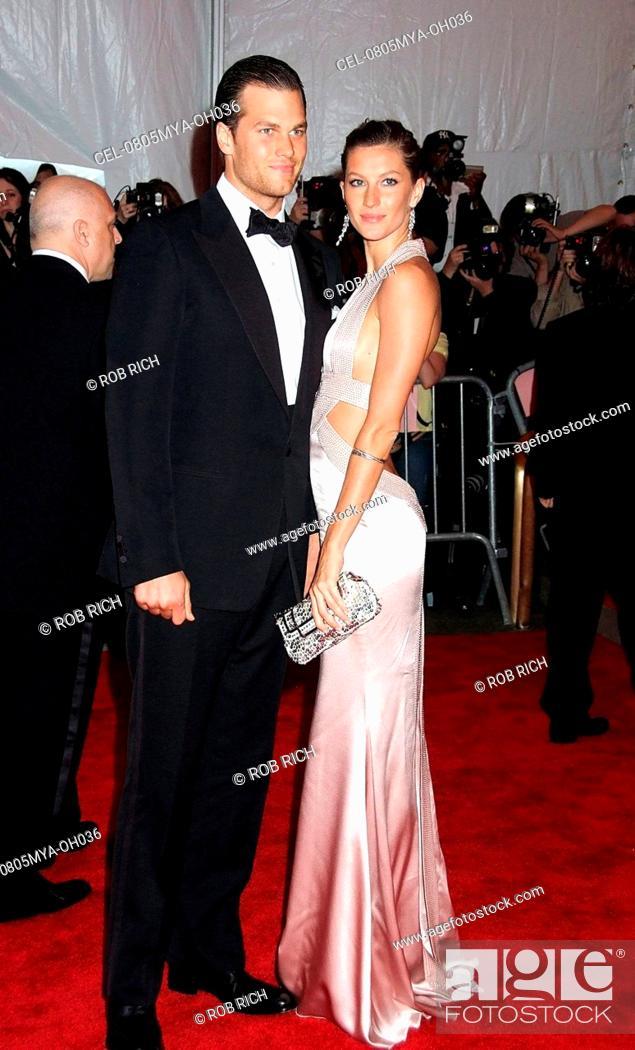 Tom Brady (wearing a Tom Ford suit), Gisele Bundchen (wearing a ...