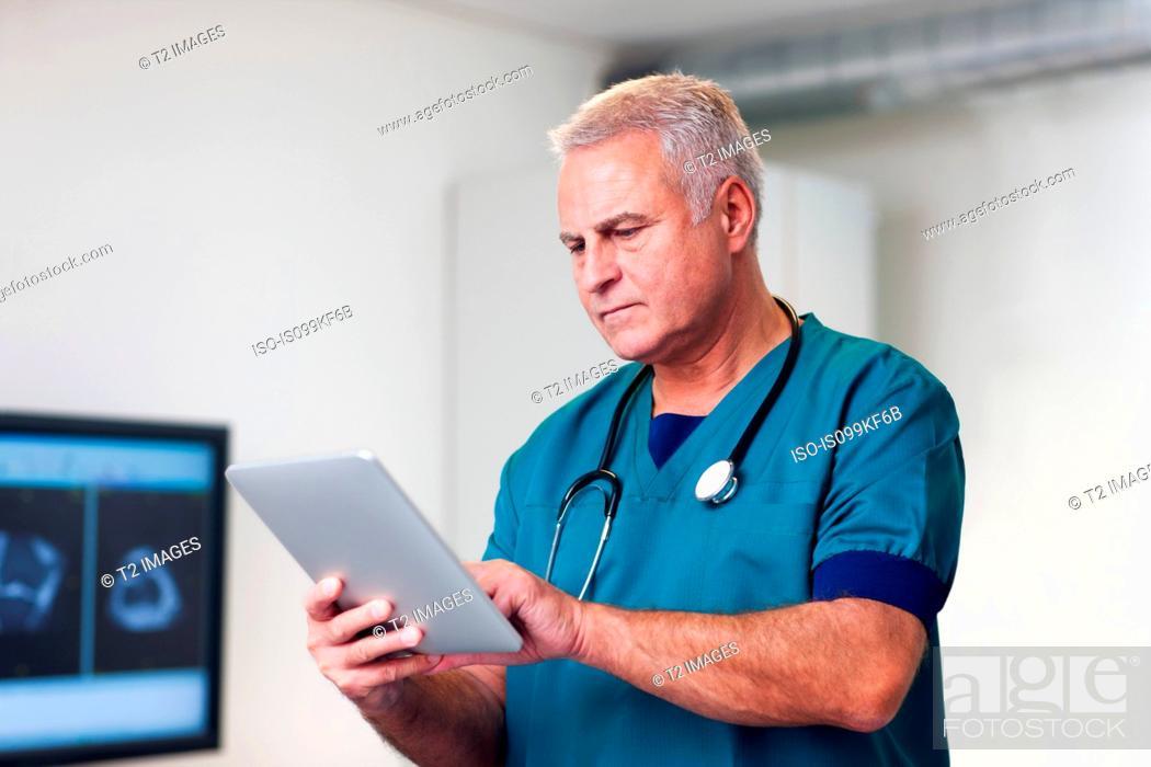 Stock Photo: Doctor using digital tablet.
