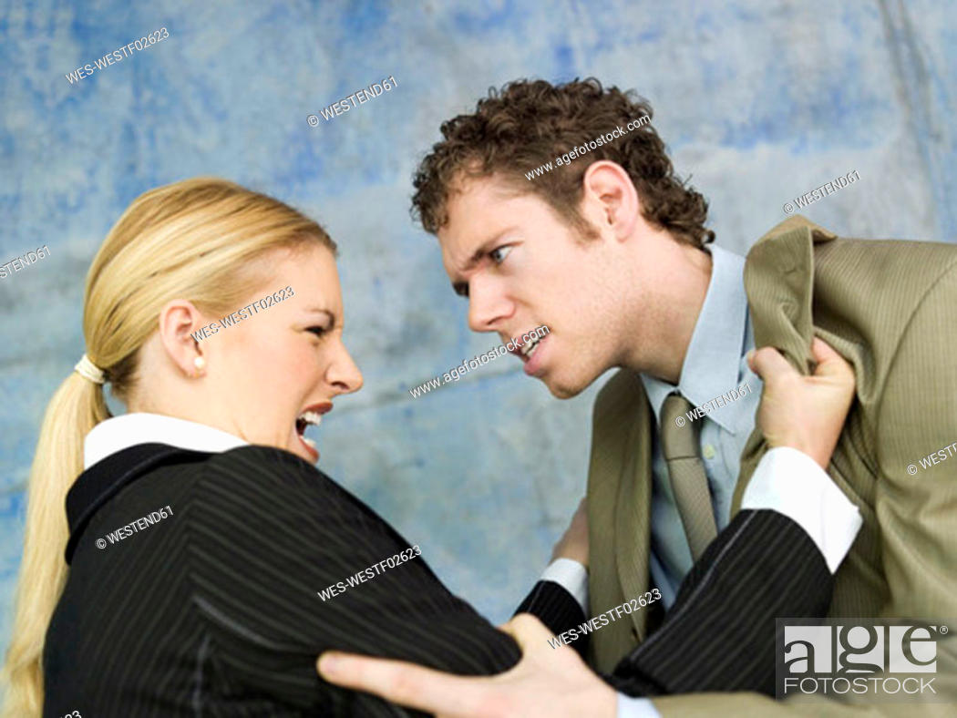 Stock Photo: Businessman and businesswoman quarrelling.