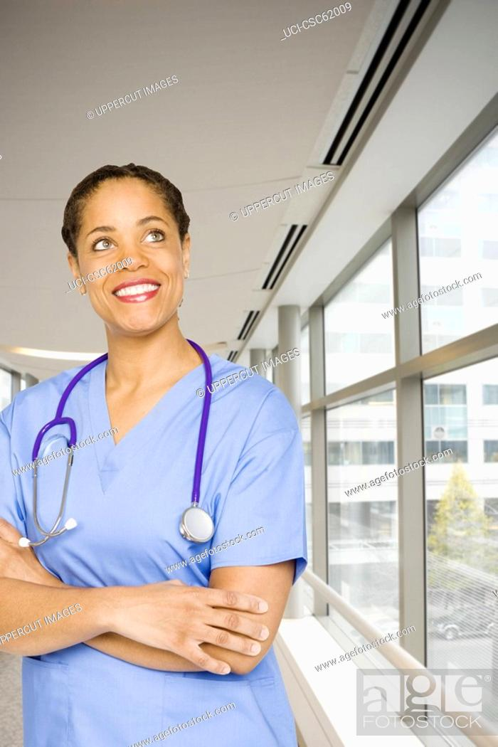 Stock Photo: Female doctor with arms crossed.