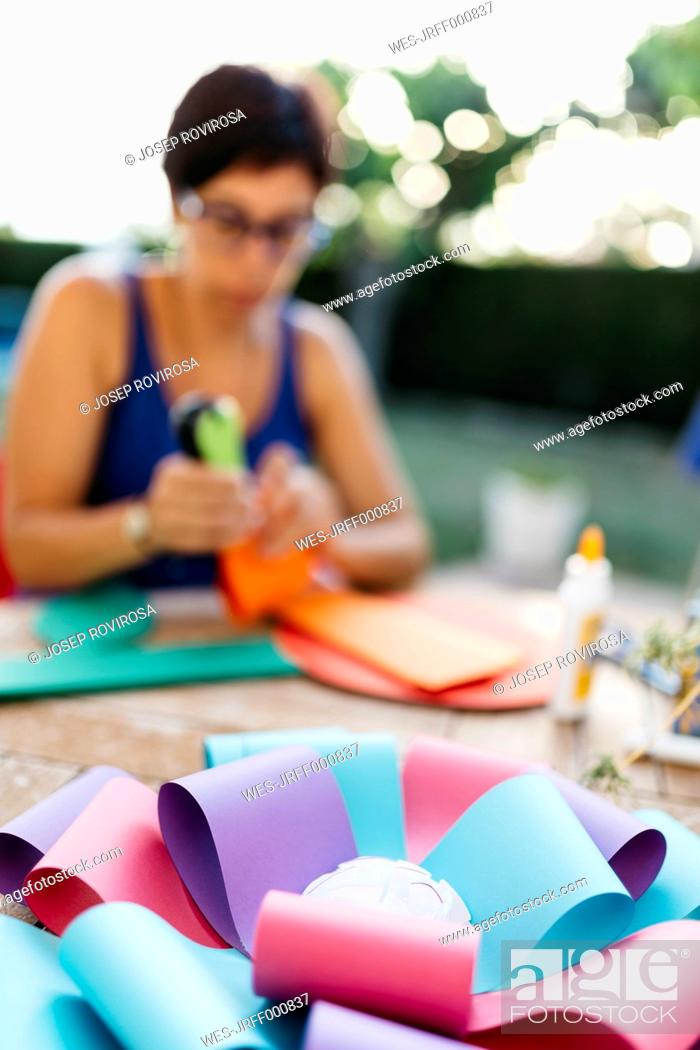 Stock Photo: Woman making a cardboard rosette.