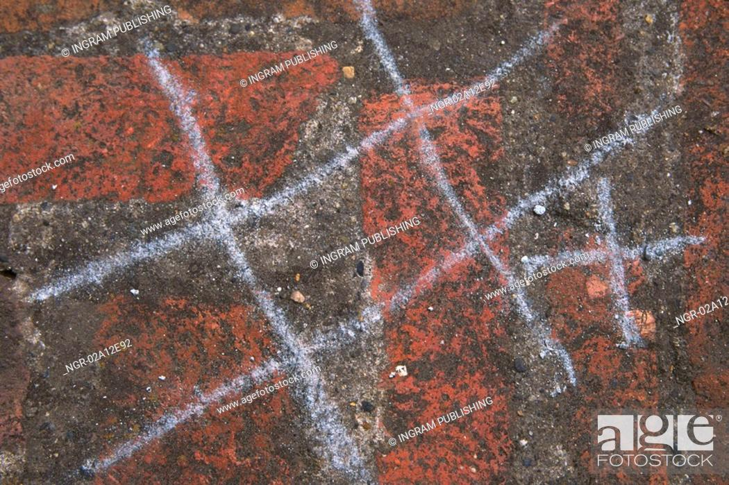 Stock Photo: Close-up of a game of tic tac toe made with chalk on a wall.