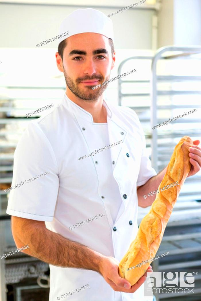 Stock Photo: VIew of a Young attarctive baker working at the bakery.