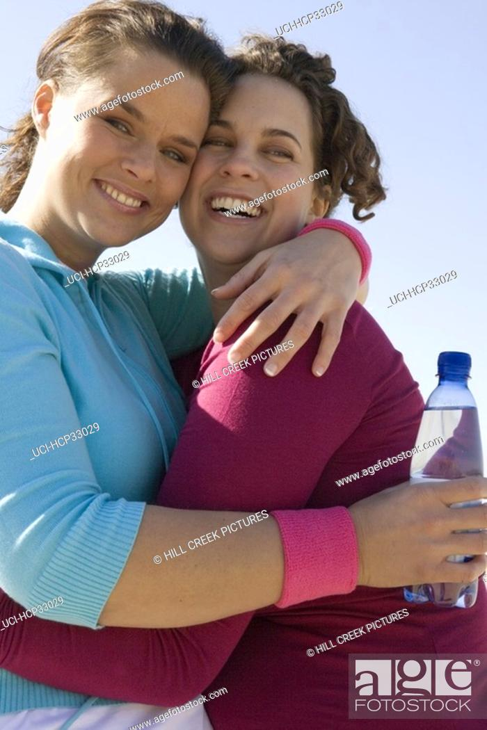 Stock Photo: Two women cheek to cheek.