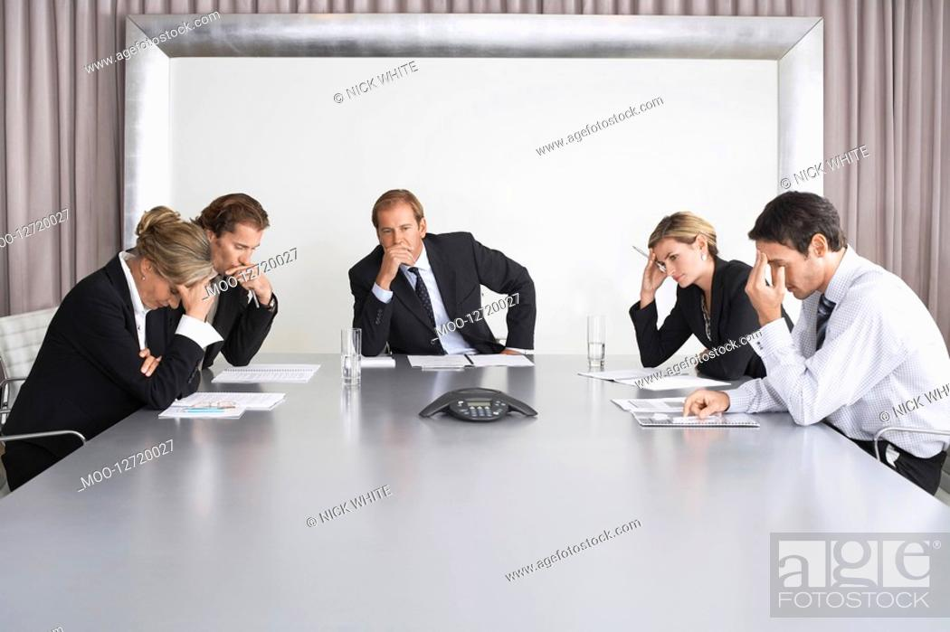 Stock Photo: Frustrated Businesspeople Listening to Conference Call.