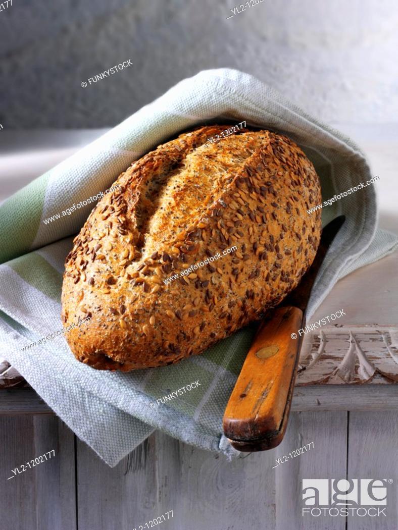 Stock Photo: Artisan organic seeded Rye bread loaf.