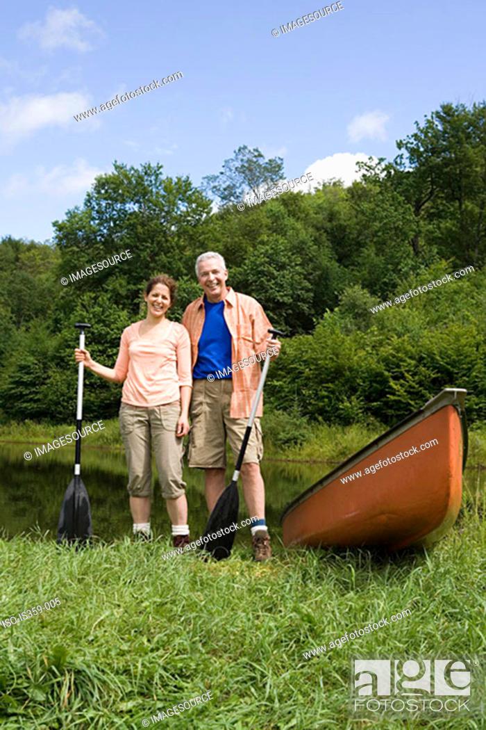 Stock Photo: Mature couple canoeing.