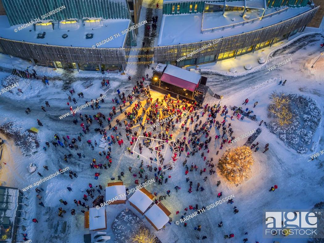 Stock Photo: Top veiw of People gathering for a Christmas Celebration, Kopavogur, a suburb of Reykajvik, Iceland. This image is shot using a drone.