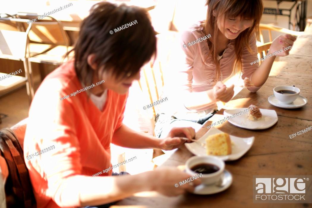 Stock Photo: Young people having coffee break.