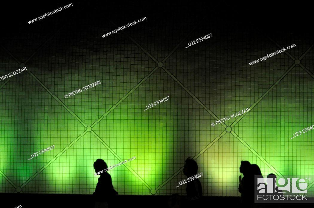 Stock Photo: Hong Kong: people by the Hong Kong Science Museum, in Tsim Sha Tsui, nighttime.