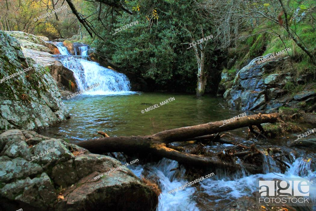 Stock Photo: A large puddle close to the El Purgatorio falls, in the wild ravine carved by the Aguilón river, near Rascafría; this is one of the first tributaries of the.