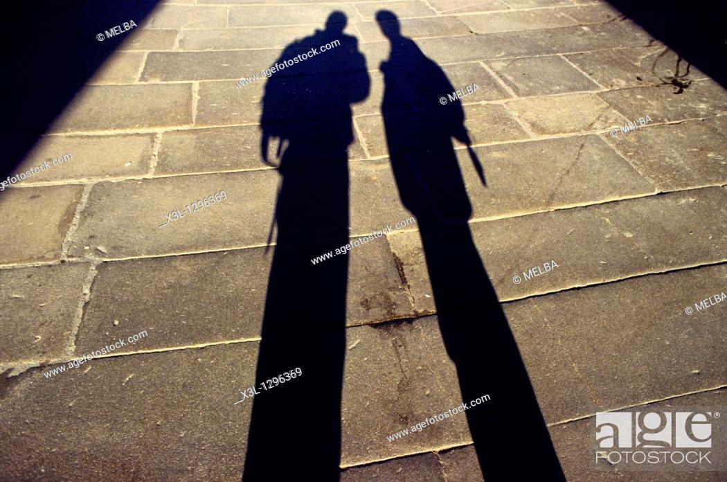 Stock Photo: Pilgrim shadows in Santiago de Compostela street  La Coruña  Galicia  Spain  The Way of Saint James.