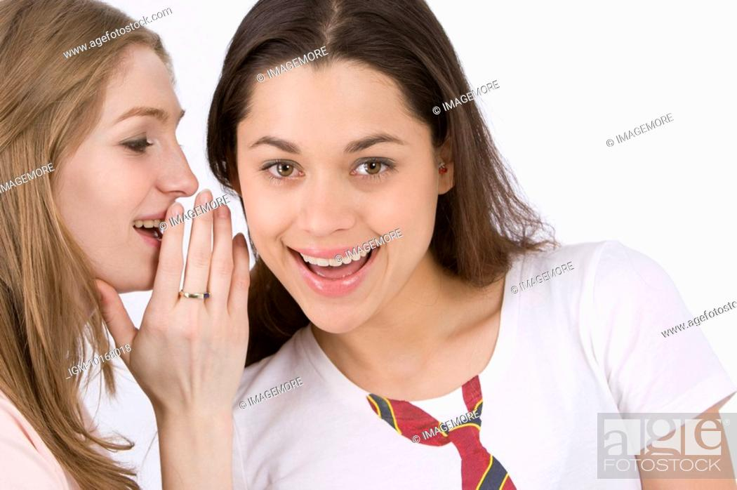 Stock Photo: Young woman whispering to friend.