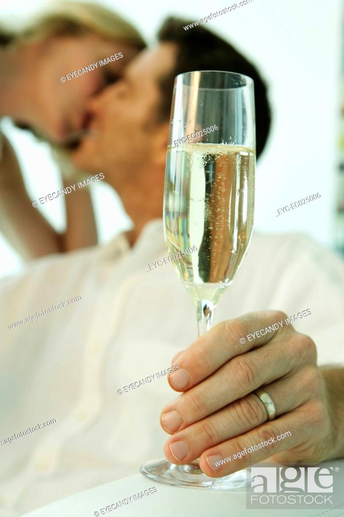 Stock Photo: View of a man holding a wineglass.