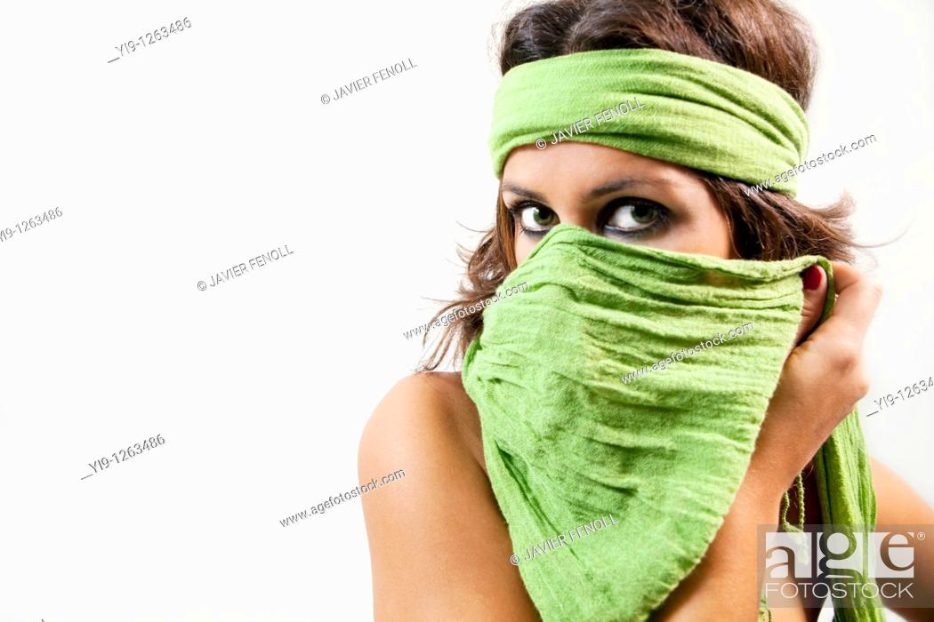 Stock Photo: Portrait of a young woman wearing a headscarf looking at camera.