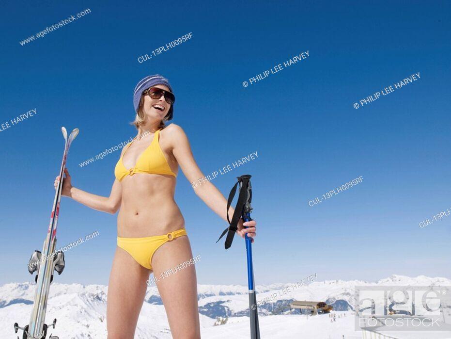 Stock Photo: woman in bikini on mountain with skis.