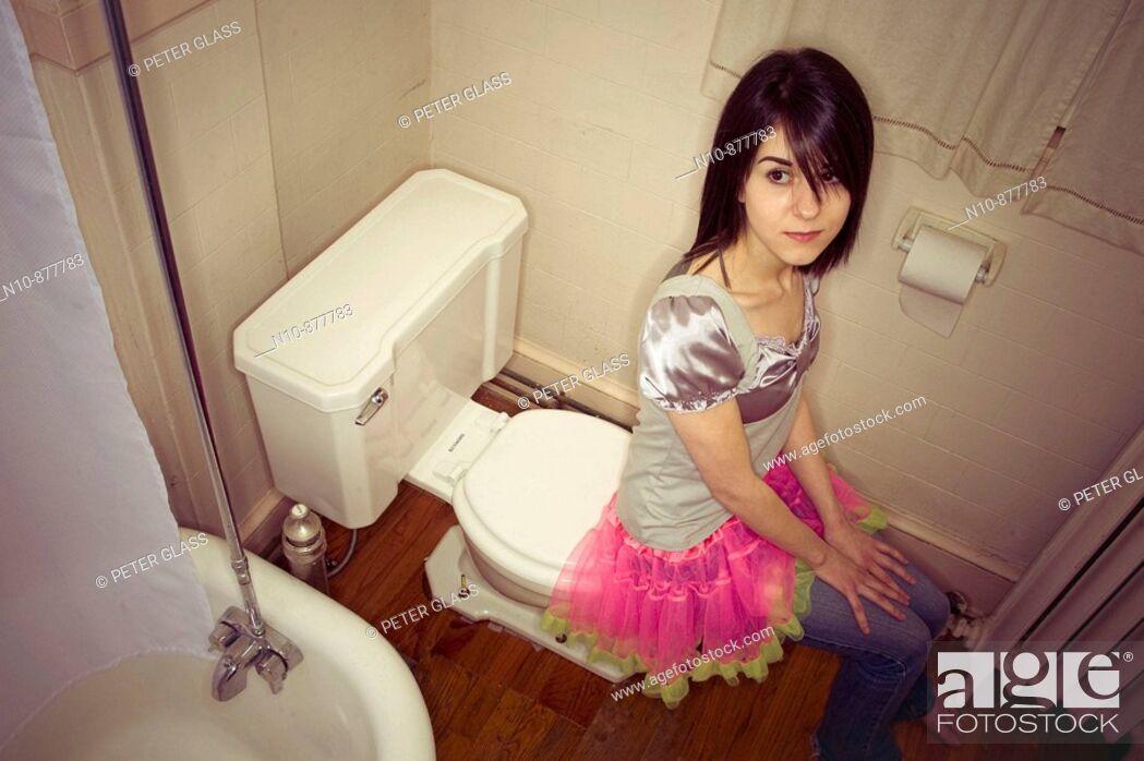 Little girl is sitting on toilet. Little girl is sitting