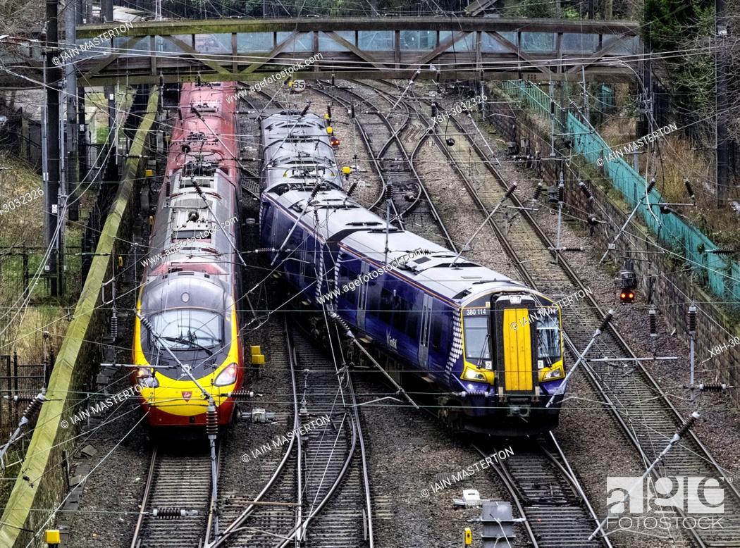 Stock Photo: Scotrail passenger train and Virgin Trains train and tracks at Waverley Station in Edinburgh, Scotland, United Kingdom.
