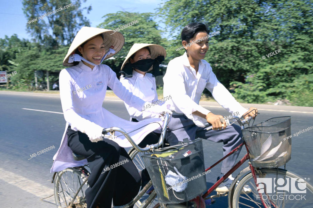 Stock Photo: Vietnam, Mekong delta, Can Tho, Students, schoolgirls, straw hats, bicycling, Southeast Asia, natives, girls, students, Women, young, Vietnamese, two, boy, man.