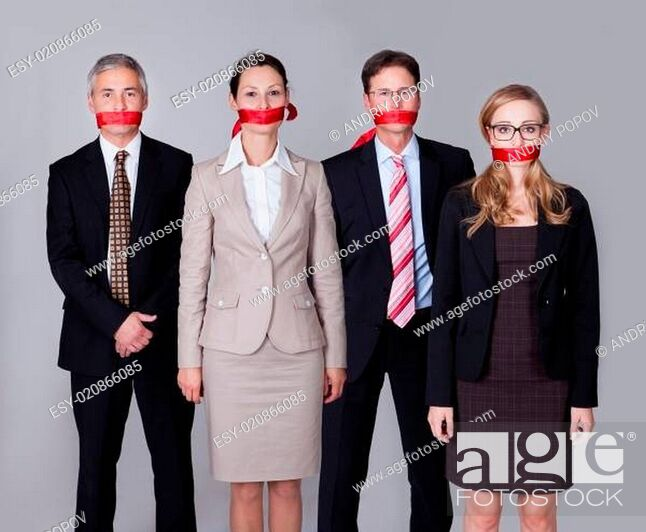Stock Photo: Businesspeople bound by red tape.