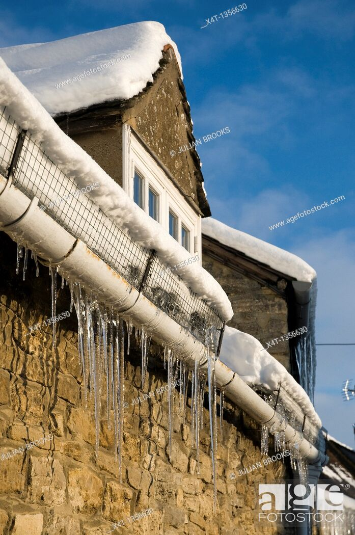 Stock Photo: icicles on a cottage in West Oxfordshire.