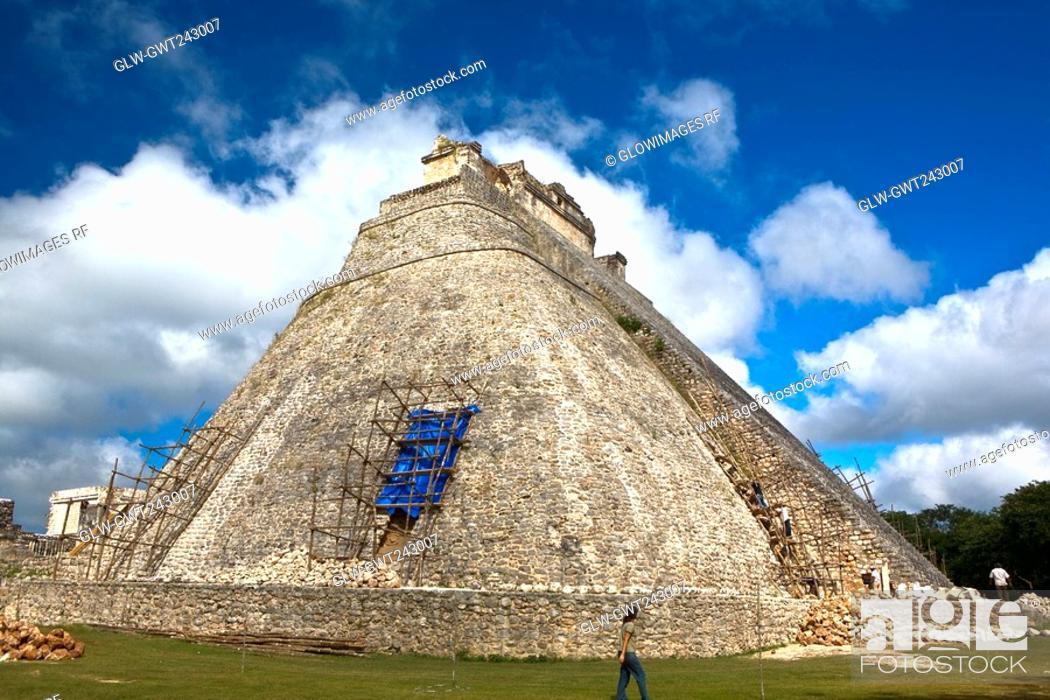 Stock Photo: Workers restoring a pyramid, Pyramid of the Magician, Uxmal, Yucatan.