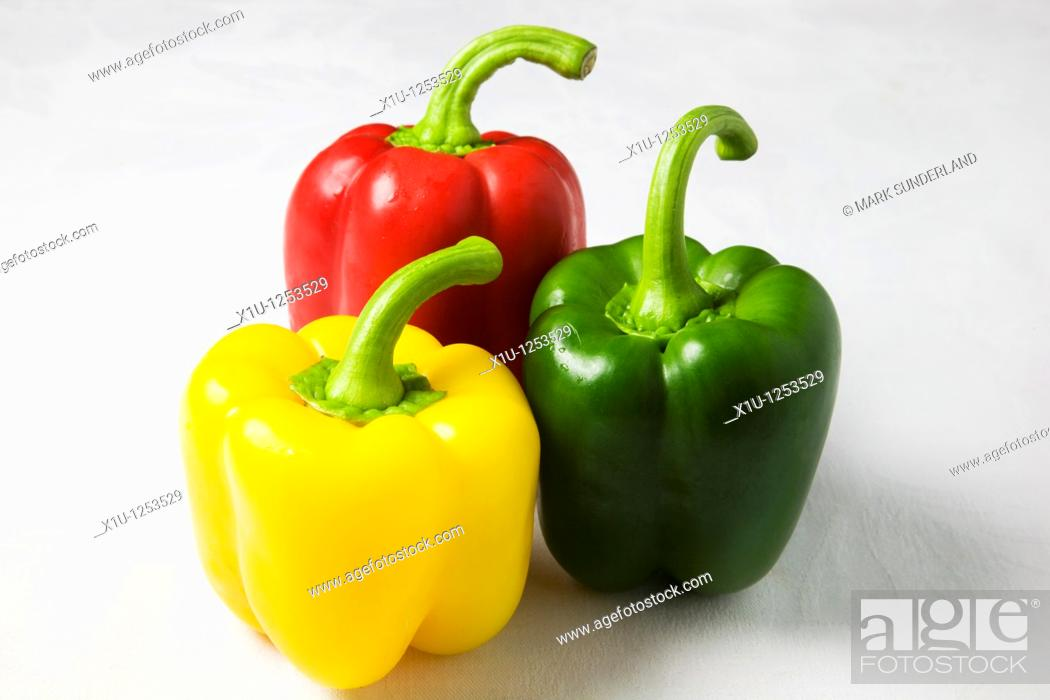 Stock Photo: Red Yellow and Green Peppers on a White Background.