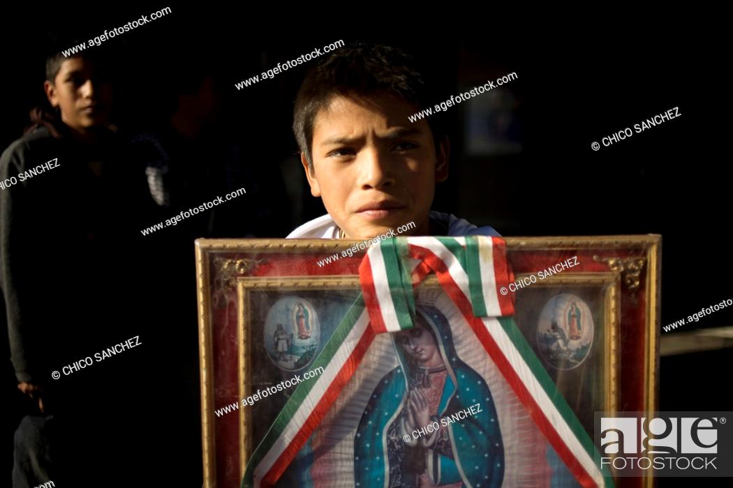 Stock Photo: A young pilgrim carries an image of the Our Lady of Guadalupe outside of the Our Lady of Guadalupe Basilica in Mexico City, December 10.