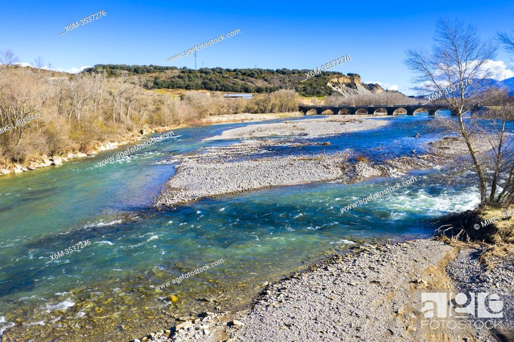 Stock Photo: Riverbed and bridge in a natural landscape. Aragon river close to Yesa reservoir. Zaragoza, Aragon, Spain, Europe.