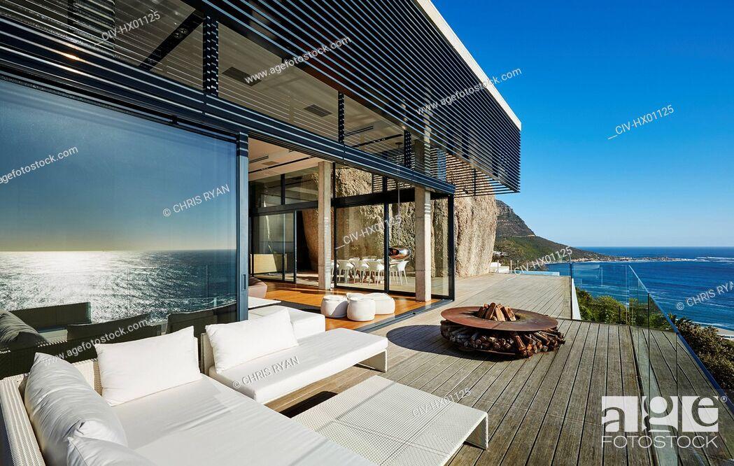 Stock Photo: Modern luxury beach house patio with sunny ocean view.