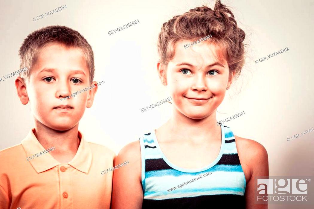 Stock Photo: Kids little girl and boy making silly face expression.