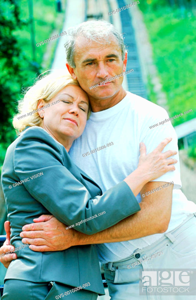 Stock Photo: Mature couple holding each other.