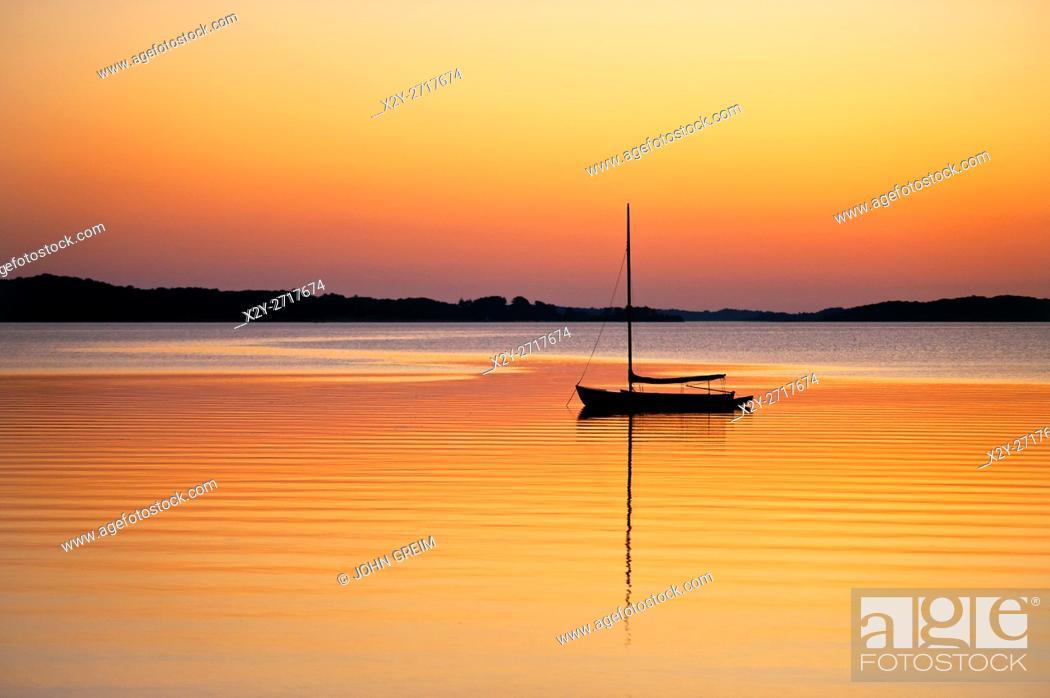 Stock Photo: Sailboat at sunset, Cape Cod, Massachusetts, USA.