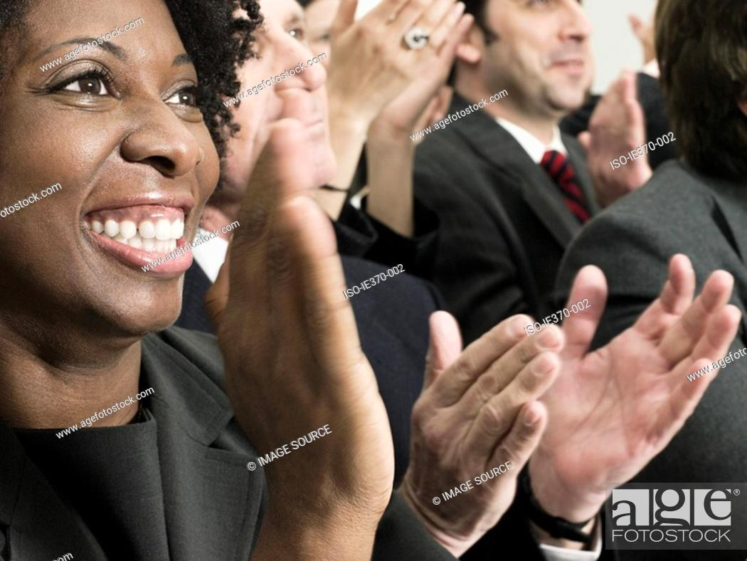 Stock Photo: Businesspeople clapping.