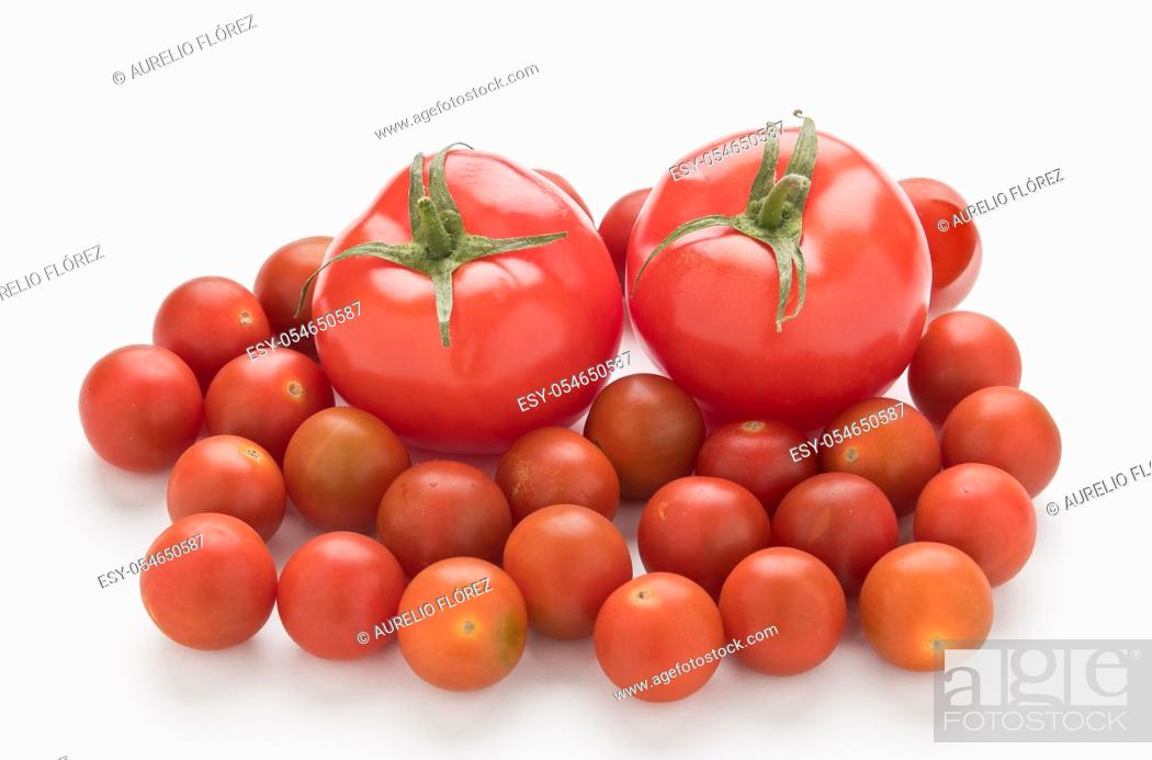 Stock Photo: Solanum lycopersicum, whose fruit is the tomato, commonly known as tomato, is a species of herbaceous plant of the genus Solanum of the Solanaceae family; it is.