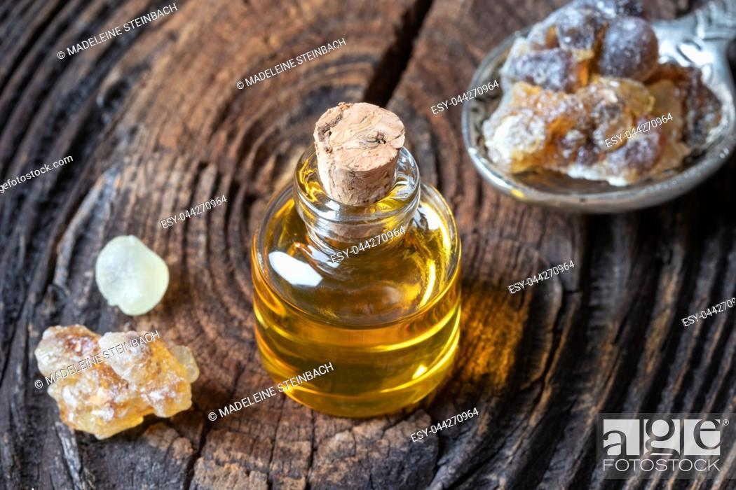 Stock Photo: A bottle of frankincense essential oil and resin.