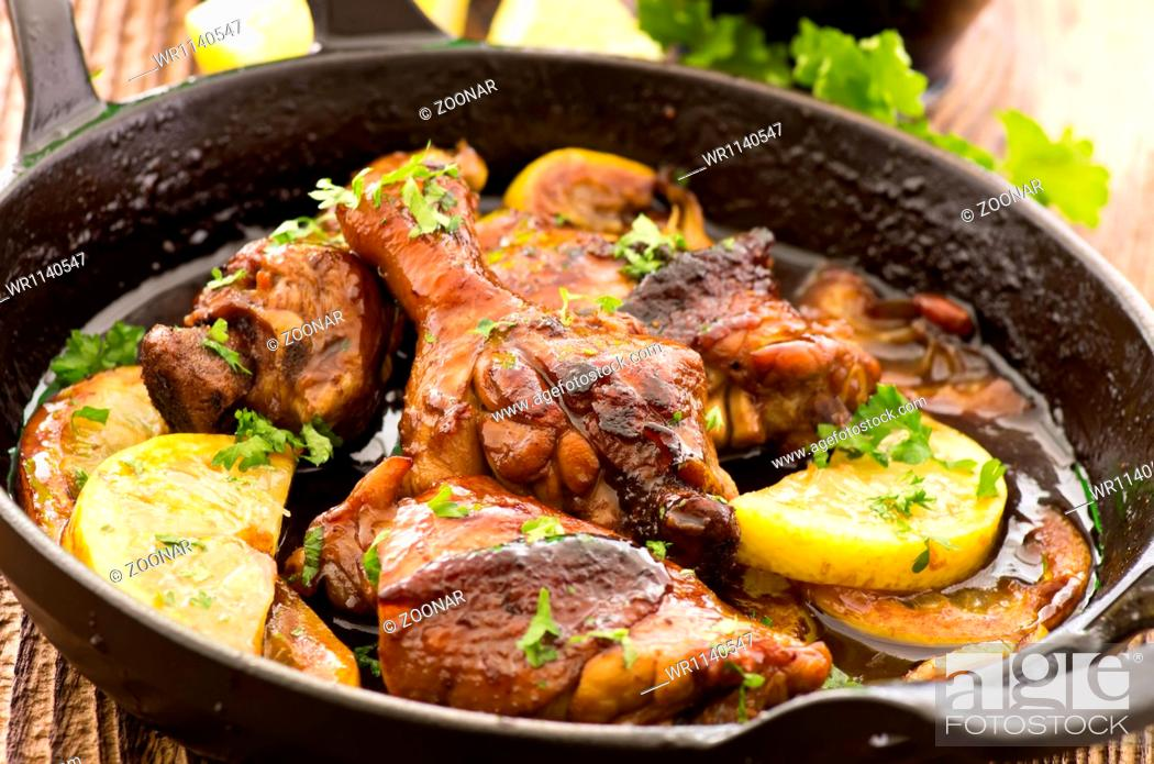 Stock Photo: lemon chicken in a pan.