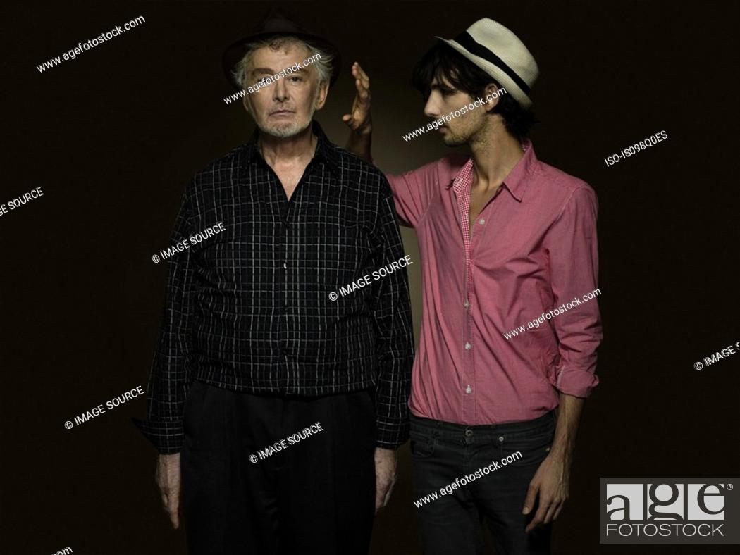 Stock Photo: Portrait of a senior and young man.
